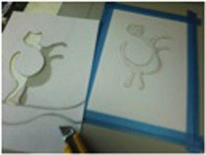 1 マスキングした刷り紙に雌型を定位置に置く。(刷り紙はマスキングテープで固定)